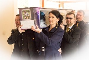 Reece's coffin is carried into the chapel. Pictured are pallbearers Stuart O'Neil, Rachel O'Neil, Martin O'Neil and Lewis Macfarlane. Photo by Mike Jackson.