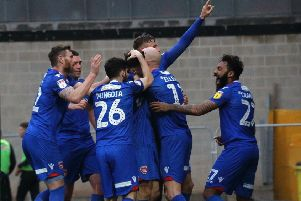 Morecambe celebrate Aaron Collins' goal at Port Vale