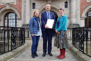 School governor Maria Farrer and Jill Gates, member of the Clapham Community Action Group, presented the action plan and petition to Stuart Carlton, corporate director of Children and Young People's Service at County Hall, Northallerton, on April 4 2019.