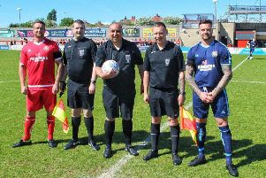 Chris and Dave Holt with the match officials before the Reece Holt Memorial Cup match. Photo by Chris Brown Photography.