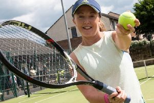 Robyn Moore, who suffers from Post Traumatic Stress Disorder (PTSD), is aiming to hit more tennis balls in one month than any other tennis player has done. Photo: Kelvin Stuttard