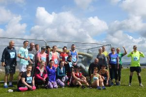 Venus and Cupid surrounded by people that took part in the 5k fun run to raise money for the statue repairs. Picture: Dawn Latham.