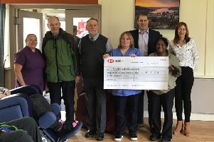 Diane and Nick Armstrong with Holehird staff and residents at the cheque presentation.