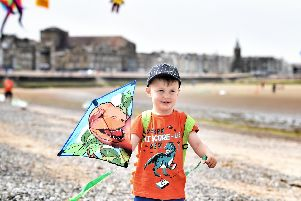 Young kite flyer Oscar Parker (three) at Catch The Wind Kite Festival, Morecambe.