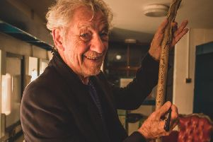 Sir Ian McKellen signs the staff used in the Dukes outdoor theatre production of The  Hobbit. A lottery will give fans the chance to win the signed staff