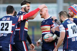 Jason Hill is congratulated on scoring one of Knights' tries.  Picture Scott Merrylees