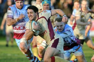 Paul Jarvis bursts past Titans' Will Thomas. Picture: Tony Johnson