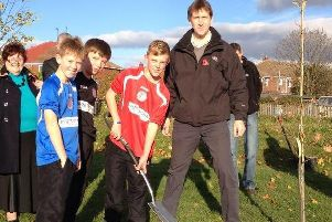 Schoolchildren pictured tree planting with Dan Jarvis