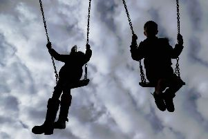 Embargoed to 0001 Tuesday September 18 File photo dated 4/3/2017 of Children playing on swings. Children are most exposed to dangerous air pollution on the school run and while they are out in the playground, experts have warned.