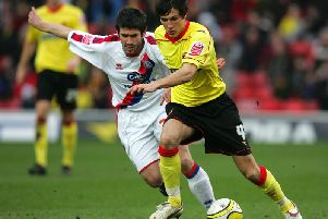 Midfielder Jack Cork in action for Watford in 2009 as he tries to fend off Crystal Palace's Danny Butterfield