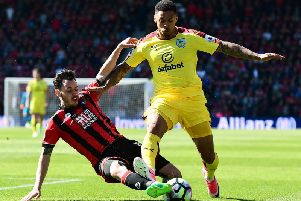 Former Burnley striker Andre Gray rides the challenge of AFC Bournemouth's Charlie Daniels