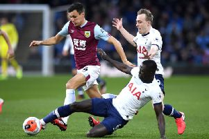 Jack Cork of Burnley is tackled by Davinson Sanchez of Tottenham Hotspur during the Premier League match at Turf Moor on March 07, 2020. (Photo by Stu Forster/Getty Images)