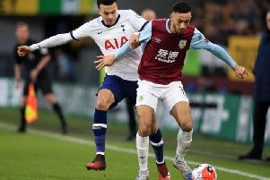 Tottenham Hotspur midfielder Dele Alli vies with Burnley midfielder Dwight McNeil during the English Premier League football match at Turf Moor on March 7, 2020. (Photo by LINDSEY PARNABY/AFP via Getty Images)