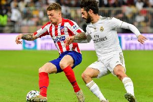Atletico Madrid's English defender Kieran Trippier (L) is marked by Real Madrid's Spanish midfielder Isco during the Spanish Super Cup final between Real Madrid and Atletico Madrid on January 12, 2020, at the King Abdullah Sports City in the Saudi Arabian port city of Jeddah. (Photo by Giuseppe CACACE / AFP) (Photo by GIUSEPPE CACACE/AFP via Getty Images)