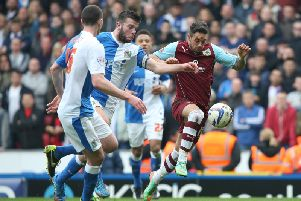 Danny Ings of Burnley battles with Grant Hanley of Blackburn Rovers during the Sky Bet Championship match between Blackburn Rovers and Burnley at Ewood Park on March 9, 2014 in Blackburn, England. (Photo by Jan Kruger/Getty Images)