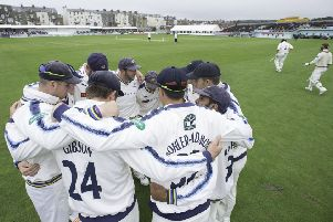 Yorkshire's team huddle as Somerset's opening batsman come out for the start of their second innings at Scarborough.