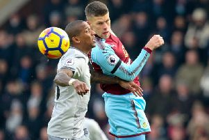 Johann Berg Gudmundsson challenges Ashley Young for the ball