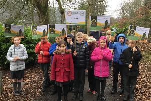 Act of solidarity: St Joseph's Primary School children during the walk around Centre Vale Park.