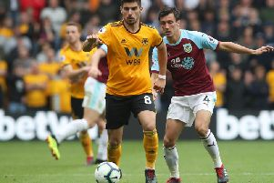 Burnley's Jack Cork keeps a close eye on Ruben Neves at Molineux earlier in the season.