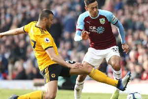 Burnley's Dwight McNeil tries to find a way past Wolverhampton Wanderers' Romain Saiss