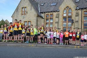 Junior runners outside the former Northowram School. Picture: Woodentops.