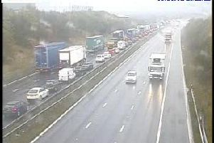 Motorists are facing delays of up to 75 minutes on the M62 at Wakefield this morning while emergency repairs are carried out. Photo: Highways England