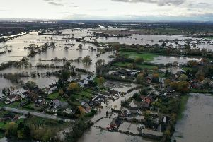 The view above the village of Fishwick, in South Yorkshire, after the River Don burst its banks with catastrophic consequences.