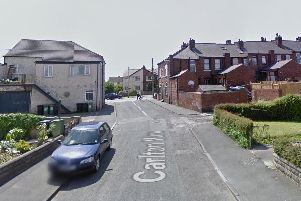 Emergency services have been called to Carlton View, just off Leeds Road.