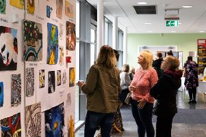 Talent on display: Visitors admire the art works