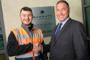 National Winner: Apprentice of the Year Wesley Bett is pictured with construction director Darren Johnson.