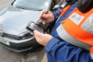 Wakefield's traffic wardens could vote for strike action.