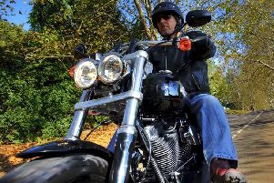 A holiday, motorbike - and a tattoo among the most common things men buy during a midlife crisis
