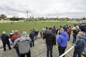 Supporters watch on at the Ingfield Stadium.
