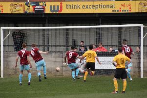 AFC Emley's Wayne Hughes (6) scores from the rebound after Hallam FC goalkeeper Dave Darwent saved his penalty. PIC: Mark Parsons.