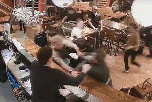 The incident was caught on camera when violence erupted at the Arc Bar, on Ash Road, Headingley.