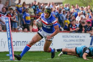 Ben Jones-Bishop escapes the tackle of Leeds' Tui Lolohea to score in Monday's derby.