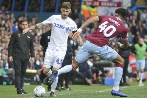 Mateusz Klich up against Aston Villa' Tyrone Mings.