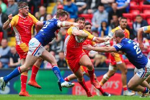 Wakefield's George King, right, and Danny Kirmond tackle Catalans Dragons' Matty Smith.