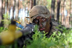 Rifleman Tom Pollard from Brighouse with the 3rd Rifles on a multi national NATO exercise at Pabrade Army training area in Lithuania. Picture: Tony Johnson.