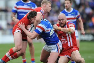 Wakefield Trinity's Jordan Crowther in no-nonsense action against Salford Red Devils in March. Picture: Dean Williams/RugbyPixUK