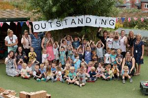 Staff and pupils celebrate getting an 'outstanding' Ofsted mark.