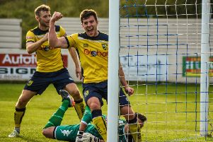 Andy Milne, front, and Tom Corner celebrate after Josh Barrett's late equaliser finds its way into the back of the net. Picture: Matthew Appleby