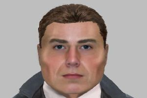 An E-fit of the man who called at the couple's address pretending to be a police officer