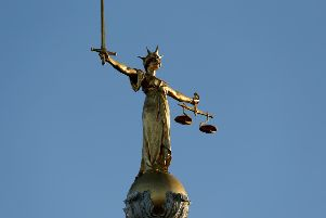 FW Pomeroy's Statue of Justice stands atop the Central Criminal Court building, Old Bailey, London.