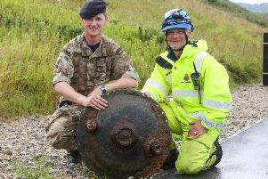 The landmine being posed with by the bomb squad and HM Coastguard. Photo: Ceri Oakes Photography
