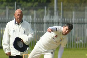 Umpire Mick Stubbs looks on as Brid's Pete Bowtell bowls