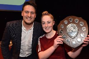 Daisy Stokoe picks up her sports award from James Kirton