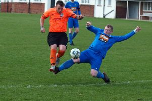 Ayton man of the match James Cooke gets stuck in against Snainton'''PICTURE BY STEVE LILLY