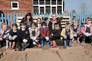 East Whitby Academy set to work on their new garden area. Teacher Sally Clarkson and TA Sam Middlemiss with the kids pic Richard Ponter