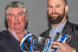 Alex White is handed the Players Player of the Year Award by Ivor Homer - White also won the Internet Player of the Year       PICTURES BY BRIAN MURFIELD